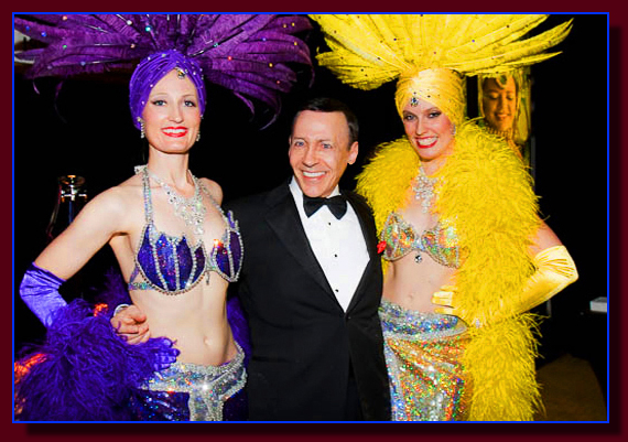 A Rat Pack Impersonator with Las Vegas Showgirls