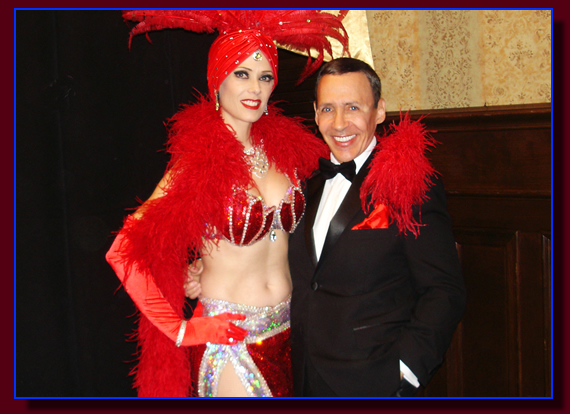 Portraying Frank Sinatra with a Las Vegas showgirl.